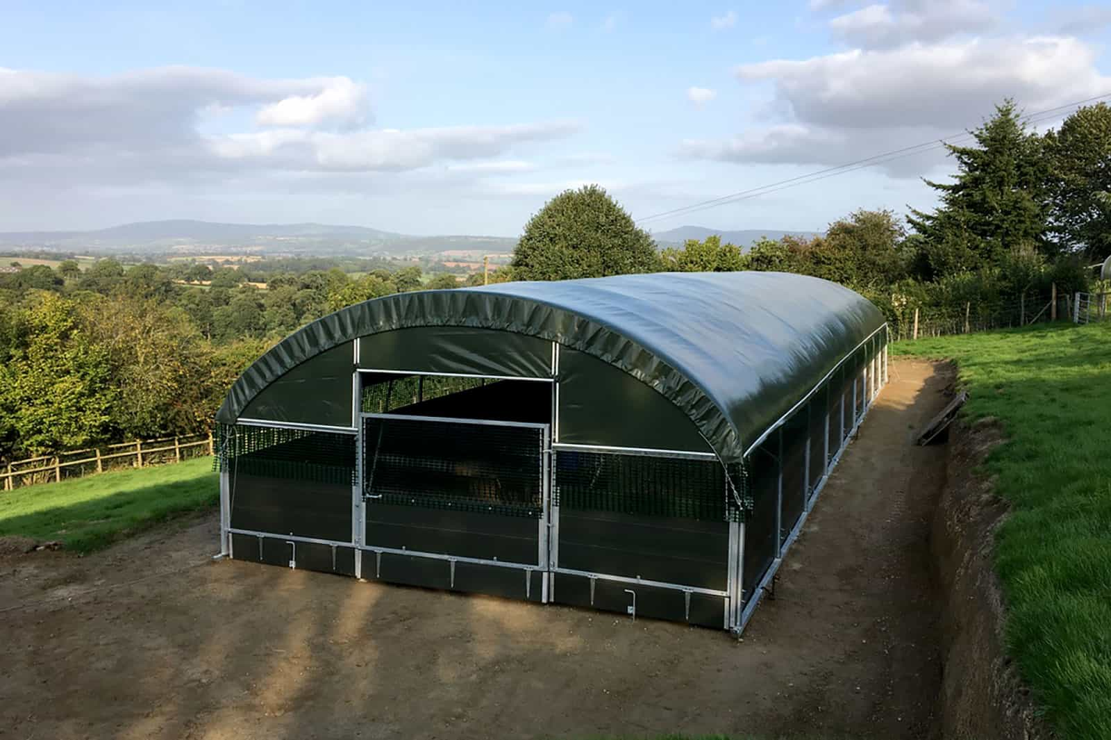 Goat House - MGH 5500 external front view - high welfare goat housing by McGregor Polytunnels