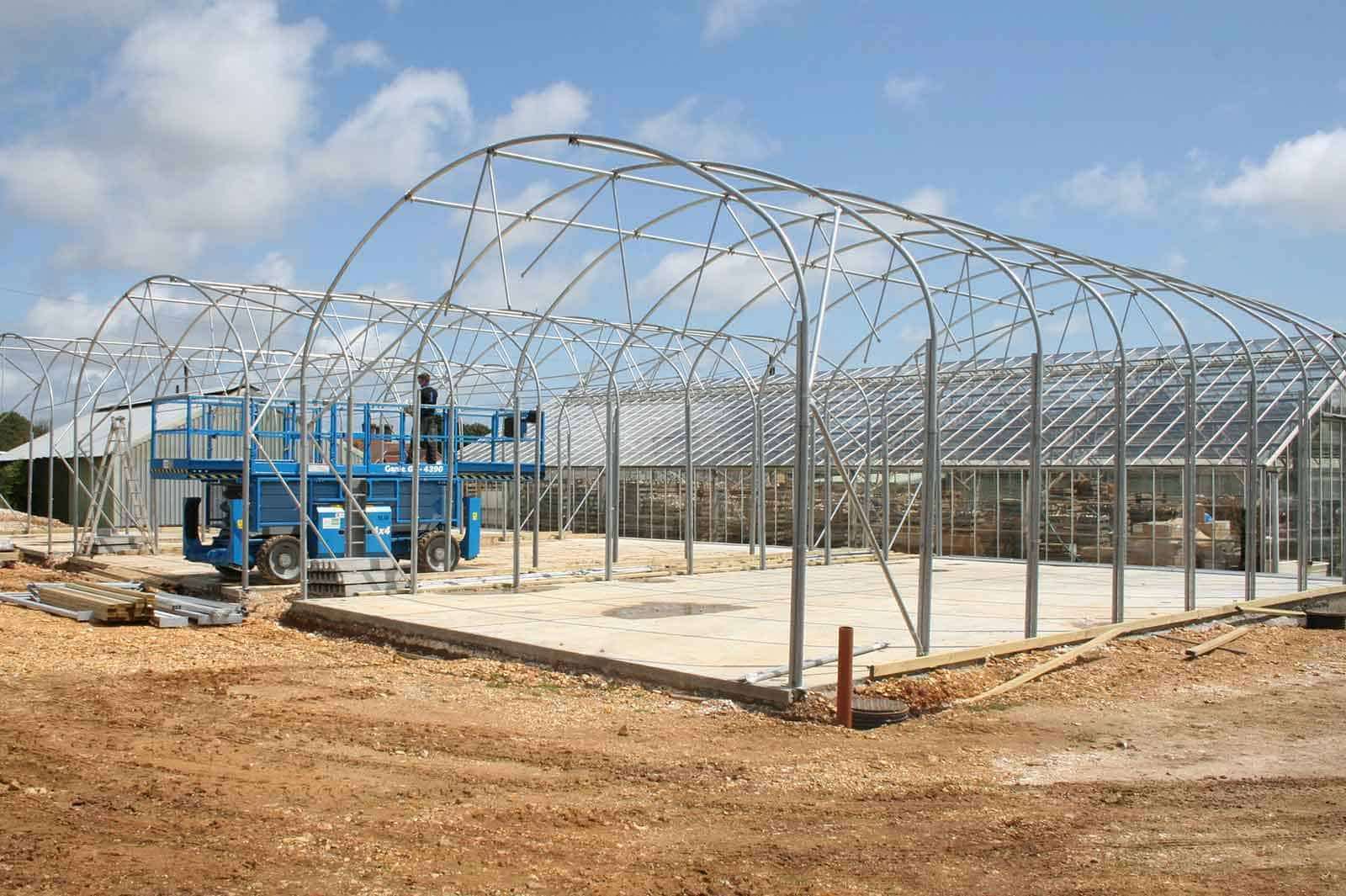 Commercial design & build - steel framed curved roof fabric structure designed and manufactured by McGregor Polytunnels