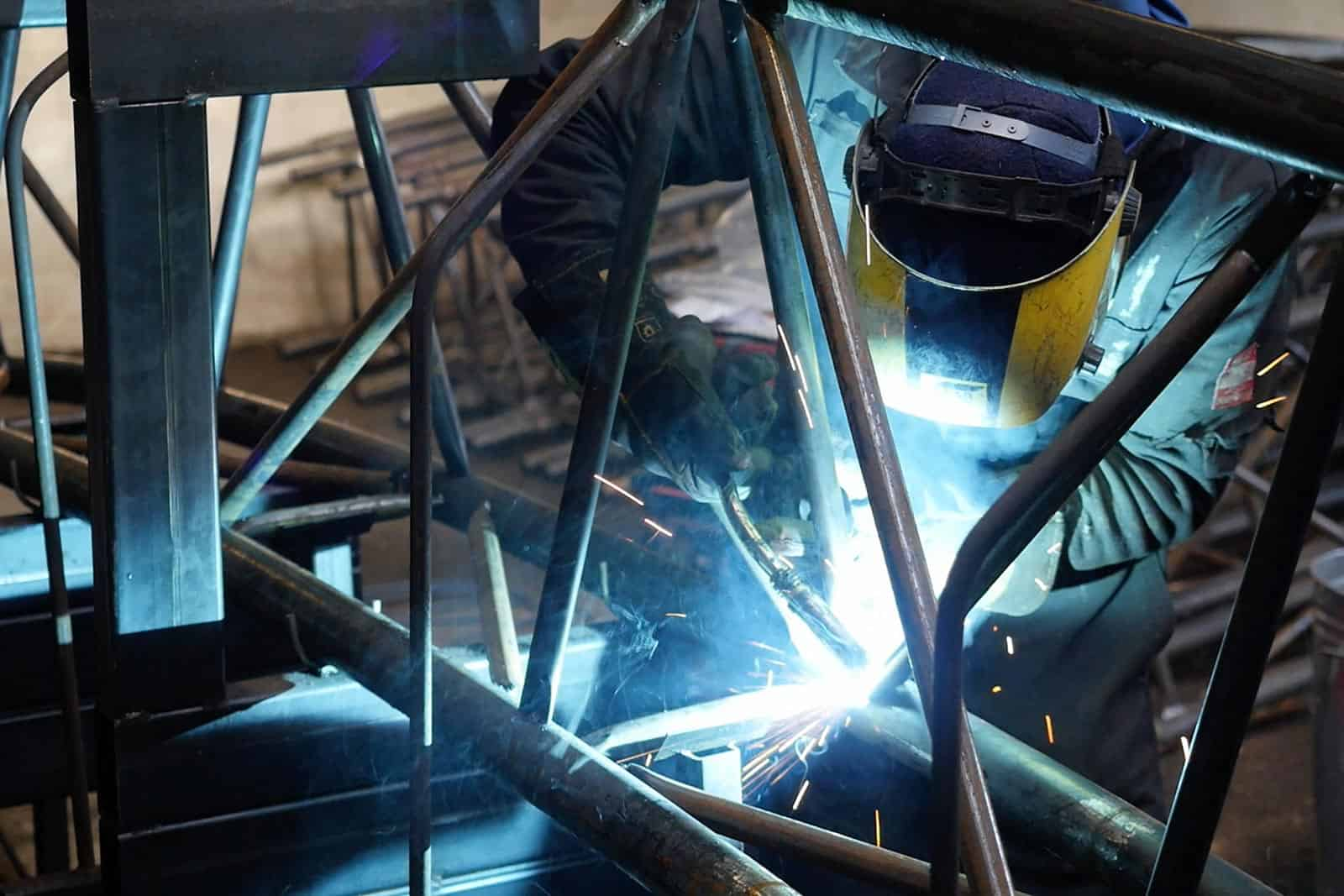 Welding a steel frame - McGregor Polytunnels manufacturing capabilities