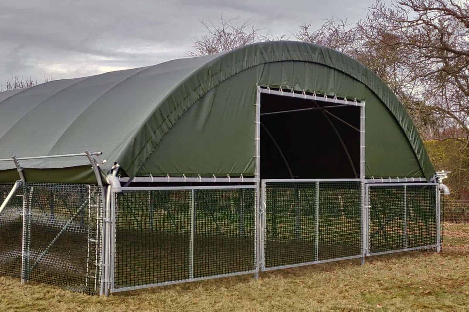 Front view of the Livestock Pop-Up Building installed on a sheep farm in Alton, Hampshire, UK by McGregor Polytunnels